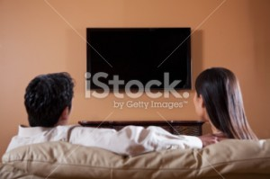 stock-photo-19614815-asian-couple-watching-tv