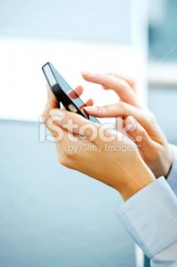 stock-photo-23379160-businesswoman-with-smart-phone
